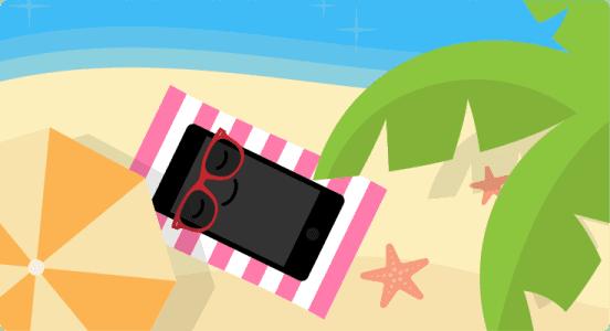 Afrekenen in het buitenland, mobieltje op het strand